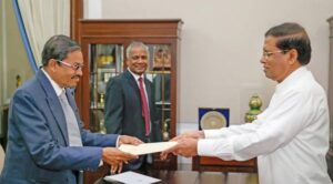 Retired Supreme Court Judge A. W. A. Salaam is receiving his appointment letter on 22.12.2016 as a member of the commission.